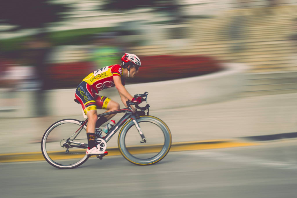 Man riding bike fast to represent acceleration