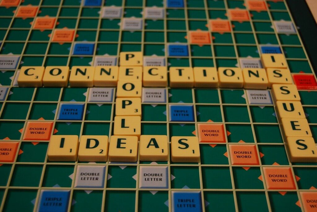 Scrabble - metaphor for cooperation, contemplation and teamwork.